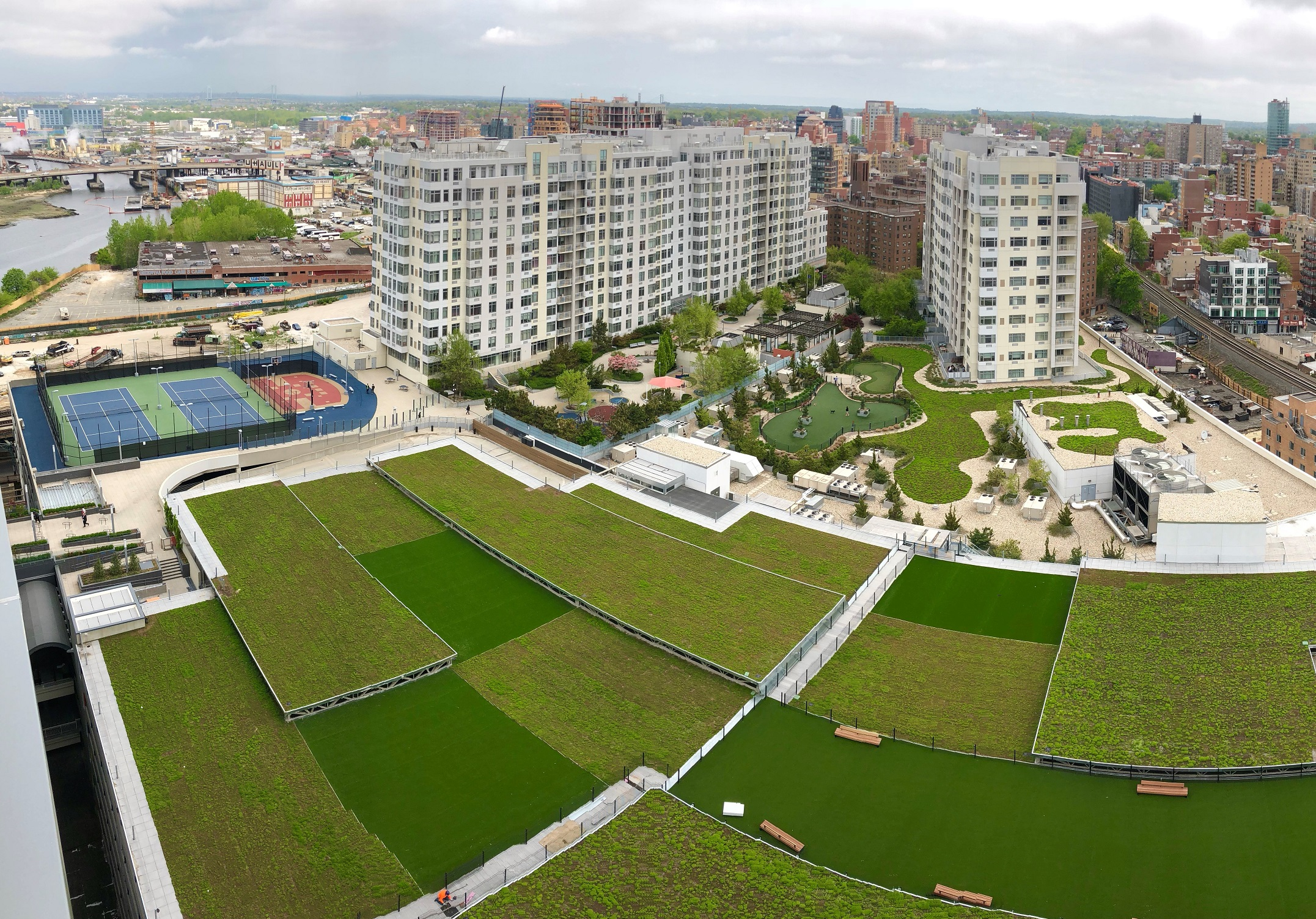 Multi-level green roof creates a cascading waterfall of vibrant green